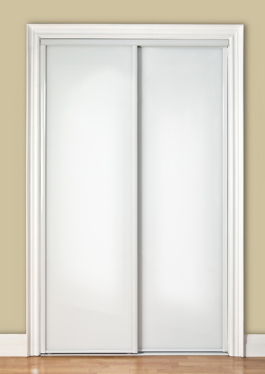 anti rattle guide for a glass sliding door